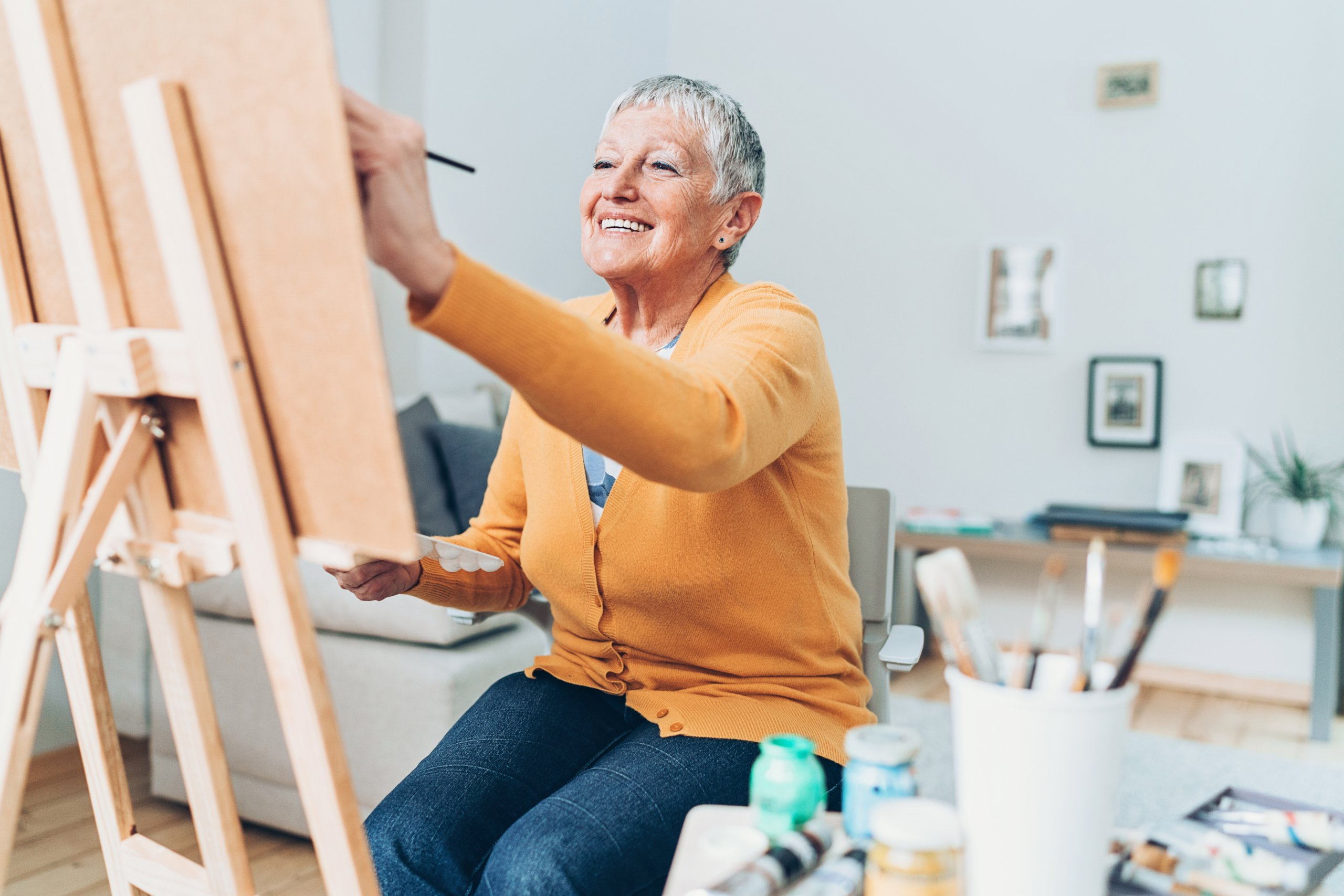 Senior artist woman drawing at home